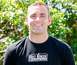 "Meet Gut Check Fitness Personal Trainer Director, Mark Lane. He was born and raised in Orange County California, Mark grew up playing sports and spending his free time enjoying the ocean and the outdoors. While studying at the University of Oregon he was a member of the club rugby team, where his love of fitness and strength training became a main focus in his life. Mark spent three years working as a personal trainer in Portland, OR. The experience he gained working with clients of all ages, shapes, and sizes was invaluable in teaching him to truly listen to people and design exercise programs that suit each individual's unique goals. With a healthy love of fitness and the outdoors, it's not hard to imagine why Mark was drawn to the Gut Check Fitness team. ""There's something about that feeling you get from running and exercising on the beach or the trail, you just can't get that from being inside a gym."""